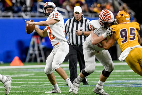 Brighton's Colby Newburg throws a pass during the second quarter of the Division 1 state football championship on Saturday, Nov. 30, 2019, at Ford Field in Detroit.