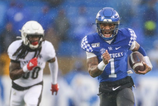 UK's Lynn Bowden, Jr. yells as he sprints down the field for another touchdown in the second half to bury Louisville at Kroger Field on a rainy Saturday afternoon. Nov. 30, 2019
