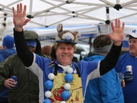 Kentucky fan Bob Bauer celebrates while tailgating before the game against Louisville. Nov. 30, 2019