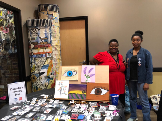 Danielle Jordan (left) and her sister, Micah, sold their own jewelry and paintings Saturday, Nov. 30, 2019, at Chef Space in Louisville's Russell neighborhood as part of the West Lou Celebration during Small Business Saturday.