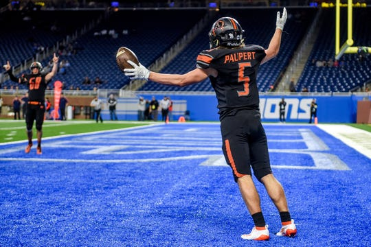 Almont's Jack Paupert celebrates his touchdown during the second quarter of the Division 5 state football championship on Saturday, Nov. 30, 2019, at Ford Field in Detroit.