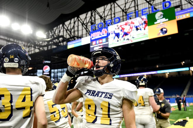 Pewamo-Westphalia's Nick Noel grabs a drink during warmups before the Division 7 state football championship against Jackson Lumen Christi on Saturday, Nov. 30, 2019, at Ford Field in Detroit.