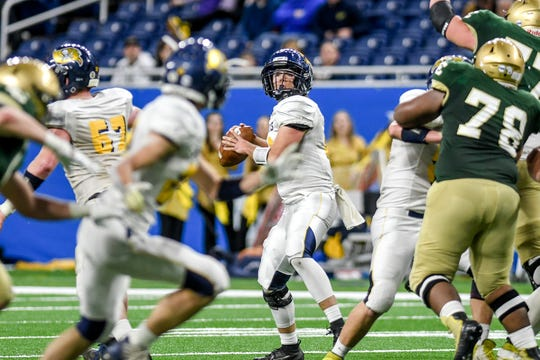 Pewamo-Westphalia's Ethan Thelen looks to throw during the second quarter of the Division 7 state football championship on Saturday, Nov. 30, 2019, at Ford Field in Detroit.