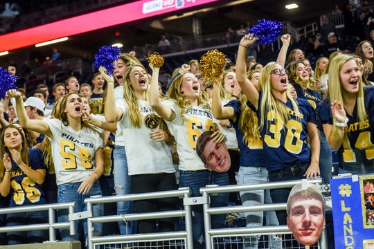 Pewamo-Westphalia fans cheer as Nate Martin returns a punt for more than 50 yards during the second quarter of the Division 7 state football championship on Saturday, Nov. 30, 2019, at Ford Field in Detroit.