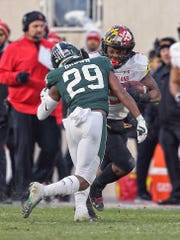Nov 30, 2019; East Lansing, MI, USA; Maryland Terrapins wide receiver Brian Cobbs (15) is tackled by Michigan State Spartans cornerback Shakur Brown (29) during the first quarter a game at Spartan Stadium. Mandatory Credit: Mike Carter-USA TODAY Sports