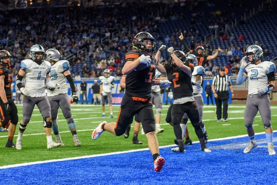 Almont's Almont's Jack Paupert scores a touchdown during the second quarter of the Division 5 state football championship on Saturday, Nov. 30, 2019, at Ford Field in Detroit.