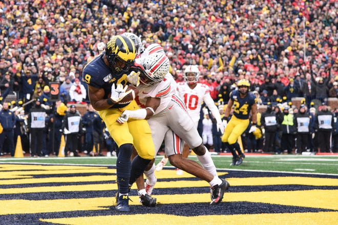 Ohio State safety Jordan Fuller knocks the ball loose from Michigan's Donovan Peoples-Jones on Nov. 30, 2019. This year's rivalry game has been moved to Oct. 24 instead of the traditional last game of the regular season.