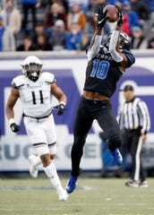 Memphis' Damonte Coxie (10) brings in a pass Friday, Nov. 29, 2019, during a game against Cincinnati at Liberty Bowl Memorial Stadium in Memphis.