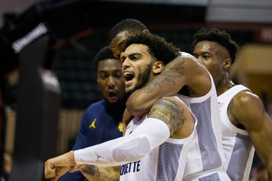 Markus Howard is congratulated by teammates during his 51-point performance Friday.