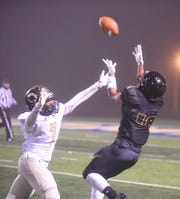 Salem's Darius Brown attempts to haul in a pass against Carlisle on Friday night.