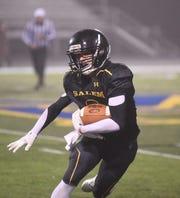 Salem's Kevin King runs after a catch on Friday night.