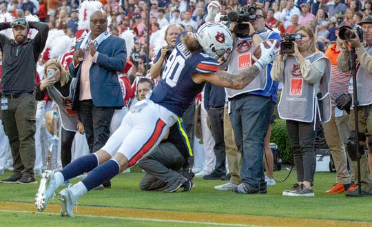 Auburn wide receiver Sal Cannella (80) catches a touchdown pass against Alabama in the Iron Bowl on Nov. 30, 2019.
