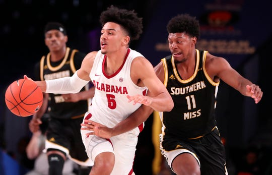 Nov 29, 2019; Nassau, BHS; Alabama Crimson Tide guard Jaden Shackelford (5) dribbles as Southern Miss Golden Eagles guard LaDavius Draine (11) defends during the second half at Imperial Arena. Mandatory Credit: Kevin Jairaj-USA TODAY Sports