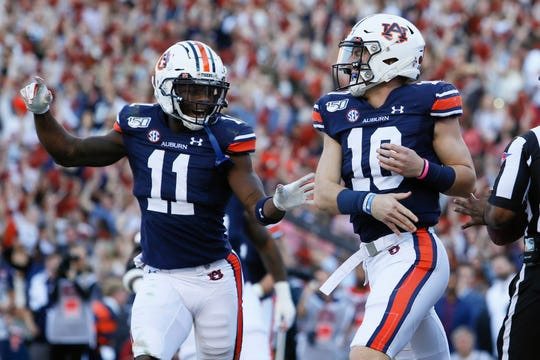 Auburn wide receiver Shedrick Jackson (11) celebrates with quarterback Bo Nix (10) after scoring a touchdown against Alabama at Jordan-Hare Stadium on Nov. 30, 2019.