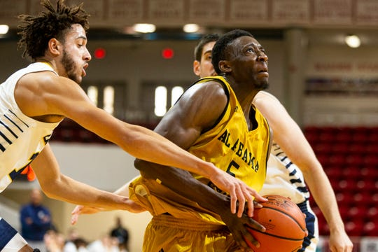 Alabama State guard Tobi Ewuosho (5) goes to the basket during an NCAA college basketball game against Chattanooga at the Emerald Coast Classic in Niceville, Fla., Friday, Nov. 29, 2019. Chattanooga defeated Alabama State 74-56. (AP Photo/Mark Wallheiser)