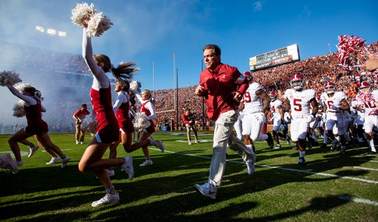 Alabama head coach Nick Saban leads his team onto the field before the Iron Bowl at Jordan-Hare Stadium in Auburn, Ala., on Saturday, November 30, 2019.