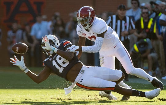 Alabama defensive back Trevon Diggs (7) breaks up a pass intended for Auburn wide receiver Seth Williams (18) in first half action in the Iron Bowl at Jordan-Hare Stadium in Auburn, Ala., on Saturday, November 30, 2019.