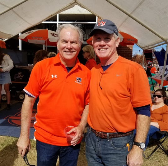 Pike Road mayor Gordon Stone (r), a former Auburn player in the '80s, enjoys tailgating activity with Sherman Goocher.
