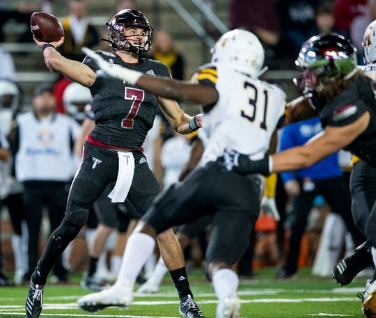 Troy quarterback Kaleb Barker (7) passes against Appalachian State in first half action on the Troy campus in Troy, Ala., on Friday, November 29, 2019.