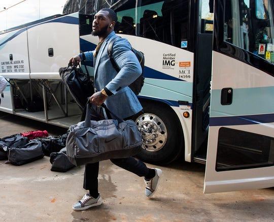 Alabama linebacker Terrell Lewis (24) arrives with the Alabama team before the Iron Bowl at Jordan-Hare Stadium in Auburn, Ala., on Saturday, November 30, 2019.
