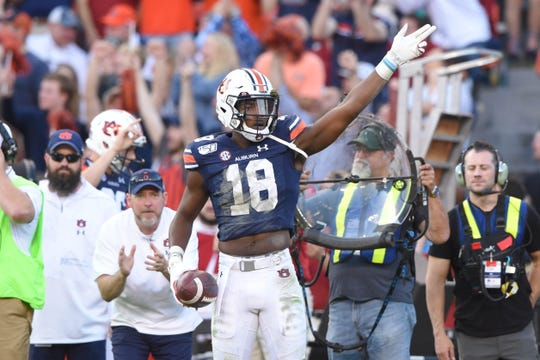 Auburn wide receiver Seth Williams (18) reacts after making a catch against Alabama in the Iron Bowl on Nov. 30, 2019, at Jordan-Hare Stadium.