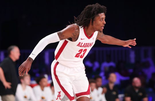 Nov 29, 2019; Nassau, BHS; Alabama Crimson Tide guard John Petty Jr. (23) reacts during the first half against the Southern Miss Golden Eagles at Imperial Arena. Mandatory Credit: Kevin Jairaj-USA TODAY Sports