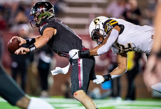 Troy quarterback Kaleb Barker (7) is sacked by Appalachian State inside linebacker D'Marco Jackson (52) in first half action on the Troy campus in Troy, Ala., on Friday, November 29, 2019.