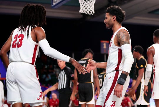 Nov 29, 2019; Nassau, BHS; Alabama Crimson Tide guard James Bolden (11) and guard John Petty Jr. (23) celebrate during the second half against the Southern Miss Golden Eagles at Imperial Arena. Mandatory Credit: Kevin Jairaj-USA TODAY Sports