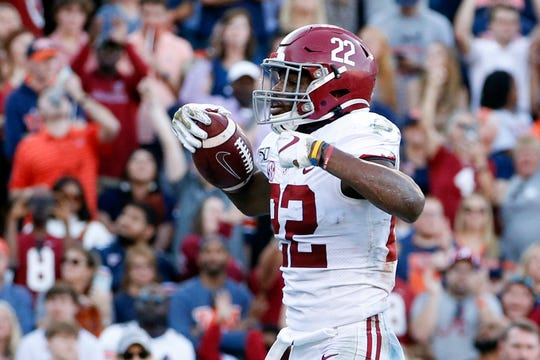 Alabama running back Najee Harris (22) celebrates after touchdown during the first half of an NCAA college football game against Auburn Saturday, Nov. 30, 2019, in Auburn, Ala. (AP Photo/Butch Dill)