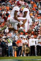 Alabama wide receiver Henry Ruggs, III, (11) and Alabama wide receiver DeVonta Smith (6) celebrate Ruggs' touchdown against Auburn in first half action in the Iron Bowl at Jordan-Hare Stadium in Auburn, Ala., on Saturday, November 30, 2019.