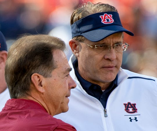 Alabama head coach Nick Saban chats with Auburn head coach Gus Malzahn during warm ups before the Iron Bowl at Jordan-Hare Stadium in Auburn, Ala., on Saturday, November 30, 2019.