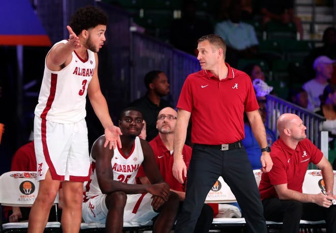 Nov 29, 2019; Nassau, BHS; Alabama Crimson Tide forward Alex Reese (3) and head coach Nate Oats speak during the second half against the Southern Miss Golden Eagles at Imperial Arena. Mandatory Credit: Kevin Jairaj-USA TODAY Sports