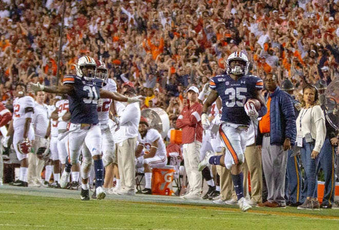 Auburn linebacker Zakoby McClain (35) runs back an interception for a touchdown against Alabama in the Iron Bowl on Nov. 30, 2019.