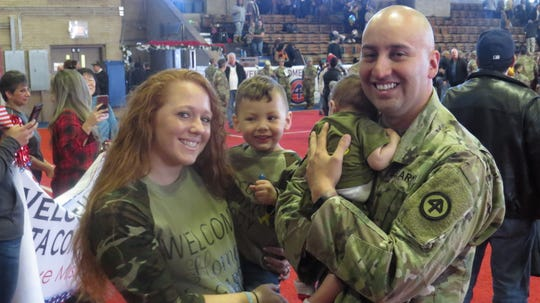 After 10 months deployed to Africa, 280 members of the National Guard 113th Infantry Regiment were welcomed home to the Teaneck National Guard Armory. Sgt. Alejandro Garcia is seen here with his wife, Stephanie, son, Maverick, 2, and his son, Leo, who was born in July while he was deployed to Africa. Saturday, Nov. 30, 2019.