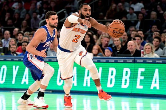 New York Knicks guard Wayne Ellington (2) is pursued by Philadelphia 76ers guard Raul Neto (19) during the first half of an NBA basketball game Friday, Nov. 29, 2019, in New York.