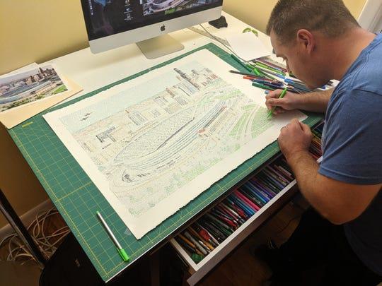 Daniel Duffy works on a Soldier Field image.