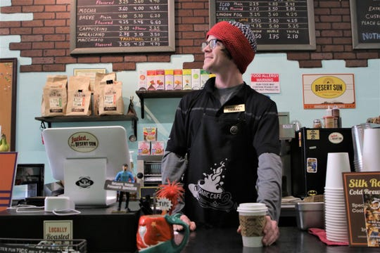 Derek Lovell of Cosmic Café in Farmington calls out a customer's order on Nov. 30, 2019, Small Business Saturday.