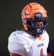Frank Peasant (1) celebrates scoring a touchdown as the Gators take a 20-7 lead during the Gaither vs Escambia playoff football game at Escambia High School in Pensacola on Friday, Nov. 29, 2019.