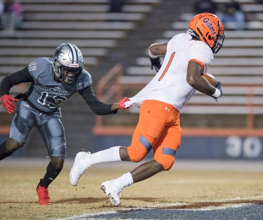 Jean Duclos (13) grabs Frank Peasant (1)'s jersey to slow him down during the Gaither vs Escambia playoff football game at Escambia High School in Pensacola on Friday, Nov. 29, 2019.