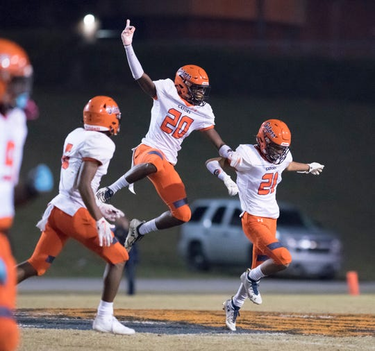 The Gators celebrate an interception during the Gaither vs Escambia playoff football game at Escambia High School in Pensacola on Friday, Nov. 29, 2019.