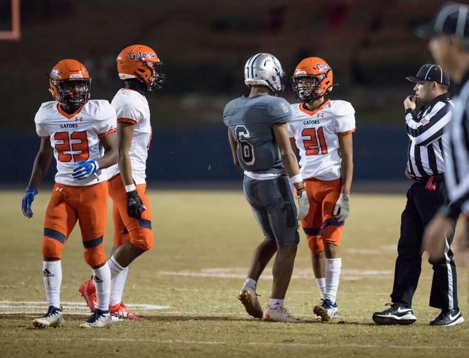 Jordan Oladokun (6) and Lamont Sims (21) exchange words in between plays during the Gaither vs Escambia playoff football game at Escambia High School in Pensacola on Friday, Nov. 29, 2019.