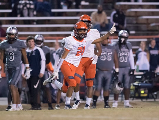 Lamont Sims (21) celebrates his interception during the Gaither vs Escambia playoff football game at Escambia High School in Pensacola on Friday, Nov. 29, 2019.