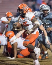 Frank Peasant (15) takes a direct snap and then runs in for a touchdown and a 39-21 Gators lead during the Gaither vs Escambia playoff football game at Escambia High School in Pensacola on Friday, Nov. 29, 2019.