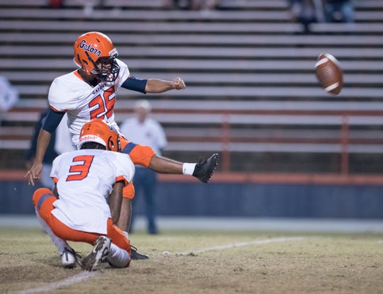 Bryan Nava (26) adds the extra point as the Gators take a 21-7 lead during the Gaither vs Escambia playoff football game at Escambia High School in Pensacola on Friday, Nov. 29, 2019.