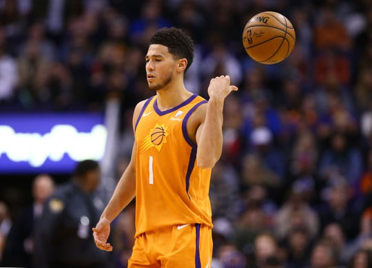 Phoenix Suns guard Devin Booker (1) reacts after a foul against the Dallas Mavericks in the second half on Nov. 29, 2019 in Phoenix, Ariz.