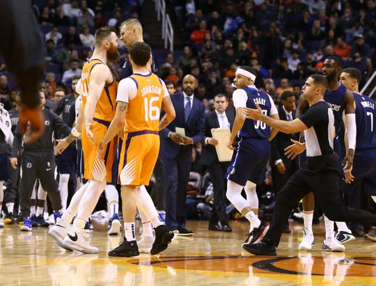 Phoenix Suns center Aron Baynes (46) gets in the face of Dallas Mavericks forward Kristaps Porzingis (6) in the first half on Nov. 29, 2019 in Phoenix, Ariz.