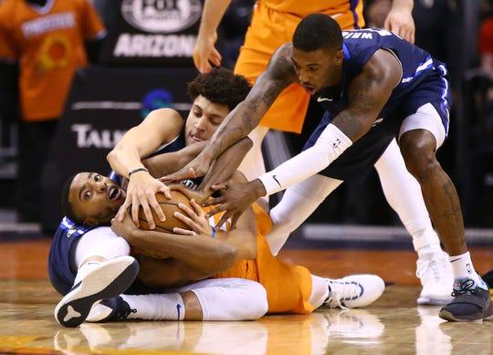 Phoenix Suns forward Mikal Bridges (25) and Dallas Mavericks forward Justin Jackson (44) battle for the ball in the first half on Nov. 29, 2019 in Phoenix, Ariz.
