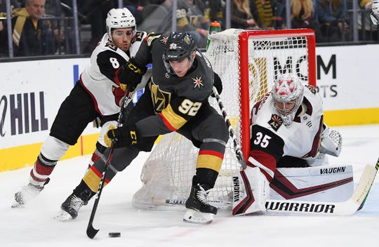Nov 29, 2019; Las Vegas, NV, USA; Arizona Coyotes goaltender Darcy Kuemper (35) protects his net as Vegas Golden Knights left wing Tomas Nosek (92) skates the puck away from Arizona center Nick Schmaltz (8) during the first period at T-Mobile Arena.