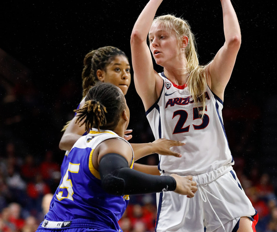 Arizona's Cate Reese works around UC-Riverside defenders on Friday, Nov. 29, 2019, at McKale Center in Tucson.
