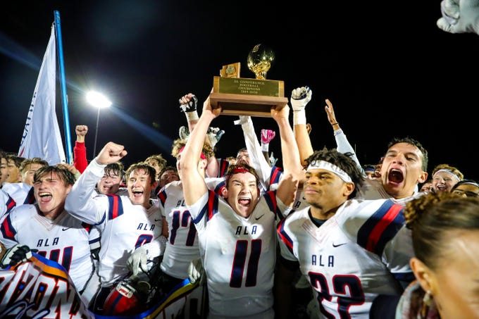 Players from ALA lift the trophy after defeating Benjamin Franklin in the 3A State Championship on Nov. 29, 2019 in Gilbert, AZ. (Brady Klain/The Republic)